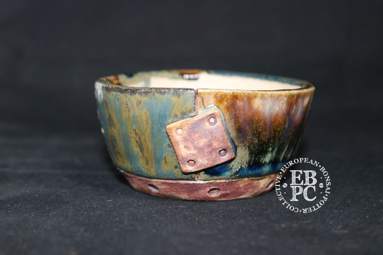 SUTEKI - 9.1cm; Accent / mame; Patch and rivet design; Round; Glazed; Browns; greens, blue; EBPC Dual Stamped Piece; Simon Haddon