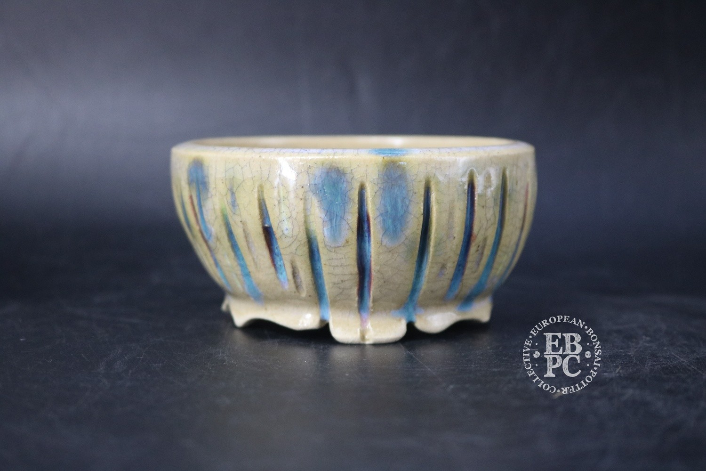 Pierre Rousseau - 10.2cm; Glazed; Carved; Round; Light crackle glaze; Blues; Reds;
