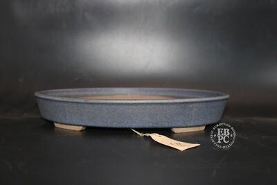 Roman Husmann - 28.9cm; Glazed; Oval; Baby Blue Glaze; Browns