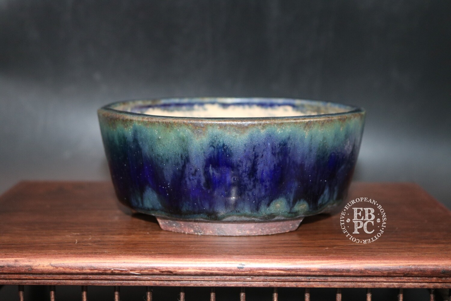 Ian Baillie - 14.8cm; Glazed; Round; Striking glaze; Blue; Ruri; Greens; Brown; Recessed feet;