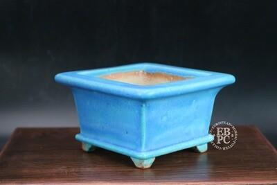 Ian Baillie - 13.2cm; Glazed; Square; Semi cascade; Stunning Turquoise glaze; Blue; Basal Band; Lip; Carved feet;