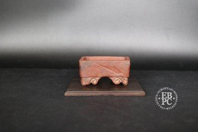 Holvila - 'Ram's head;' MAME'; 5.8cm; Unglazed; Red clay; Carved feet; Thor Holvila