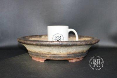 Ian Baillie - 29.4cm; Glazed; Round; Aged looking glaze; Cream; Brown;
