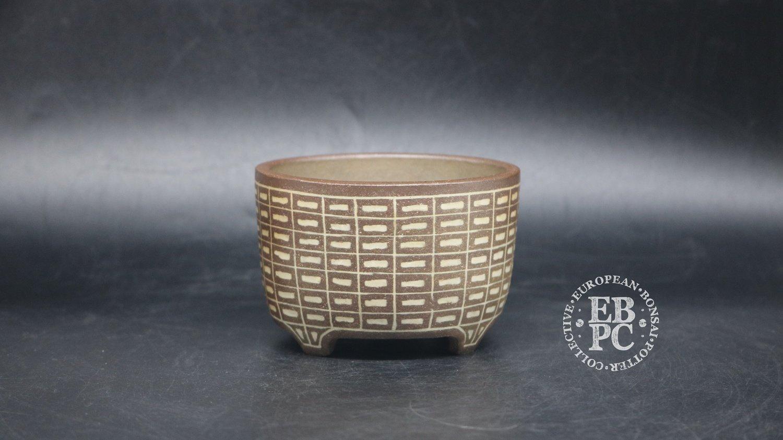 Sansai Bonsai Pots - 9.6cm; Carved; Unglazed; Round; Dark & Light brown clays, Inlay technique; Pattern; Tom Benda
