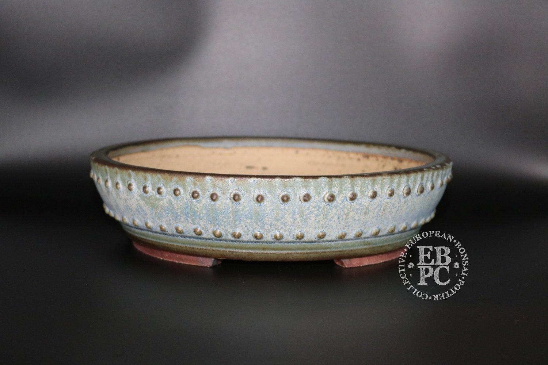 SOLD - Ian Baillie - 26.6cm; Glazed; Round; Stunning design; Light Blue / Green; Rivets