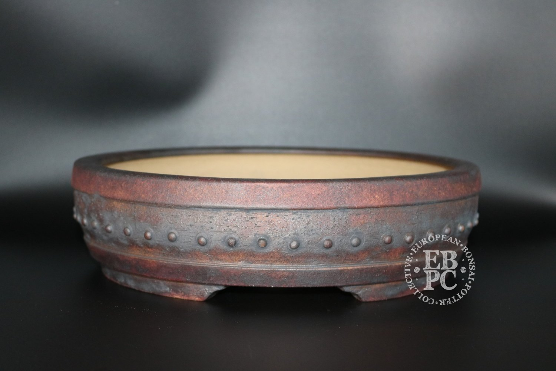 SOLD - Ian Baillie - 30.2cm Unglazed; Round; Drum; Kifu; Oxide wash; Reddish Brown;