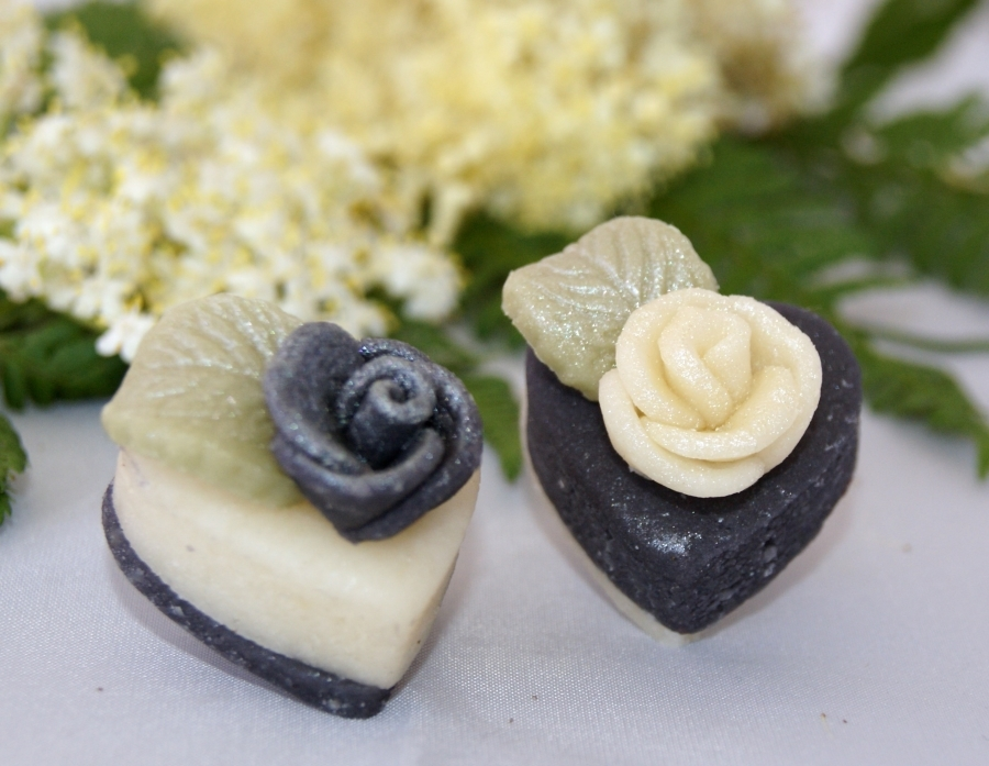 Black and white hearts make stylish petits fours.