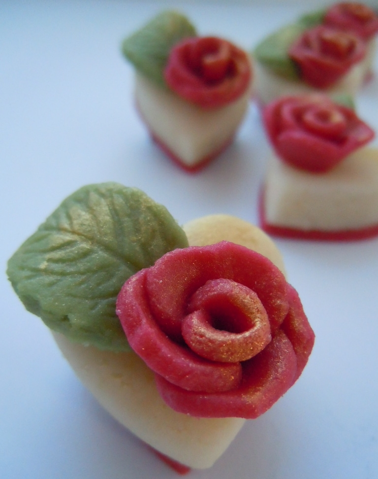 Handmade marzipan rose buds dusted with gold.