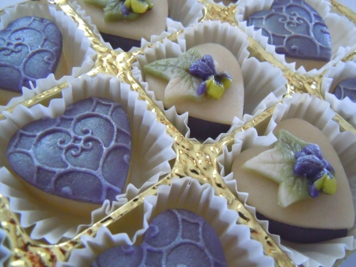 Lace effect marzipan hearts and tiny sweet violets.