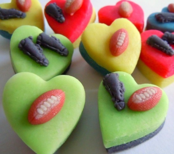 Miniature rugby balls and boots decorate marzipan hearts.