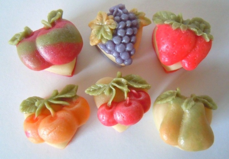 Marzipan fruit decorate plain almond hearts.