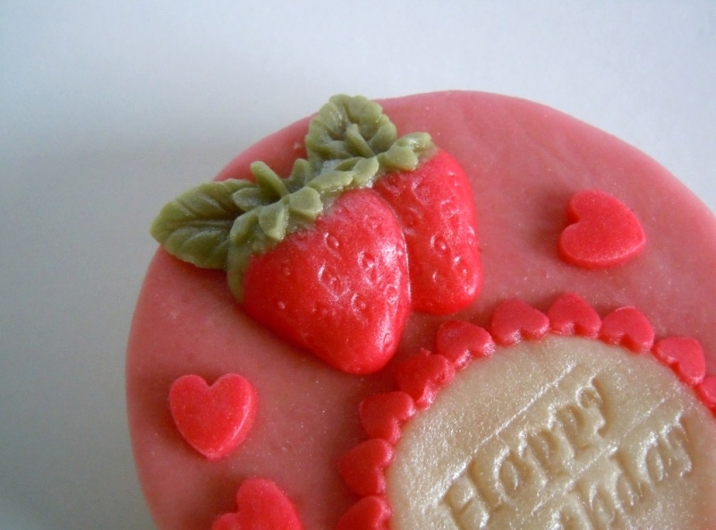 A marzipan strawberry completes the picture.