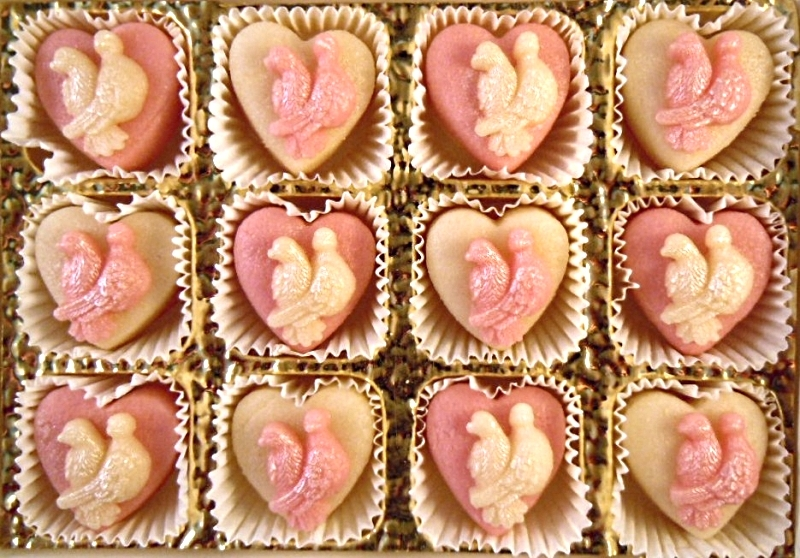 Pink and white Lovebirds on plain marzipan hearts makes a romantic gift any time of the year.