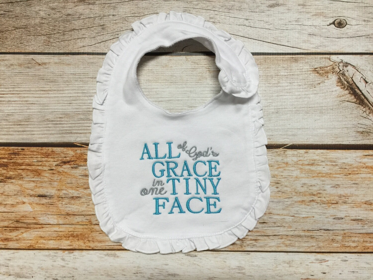 """White Ruffle Bib -  """"All of God's Grace in one Tiny Face"""""""