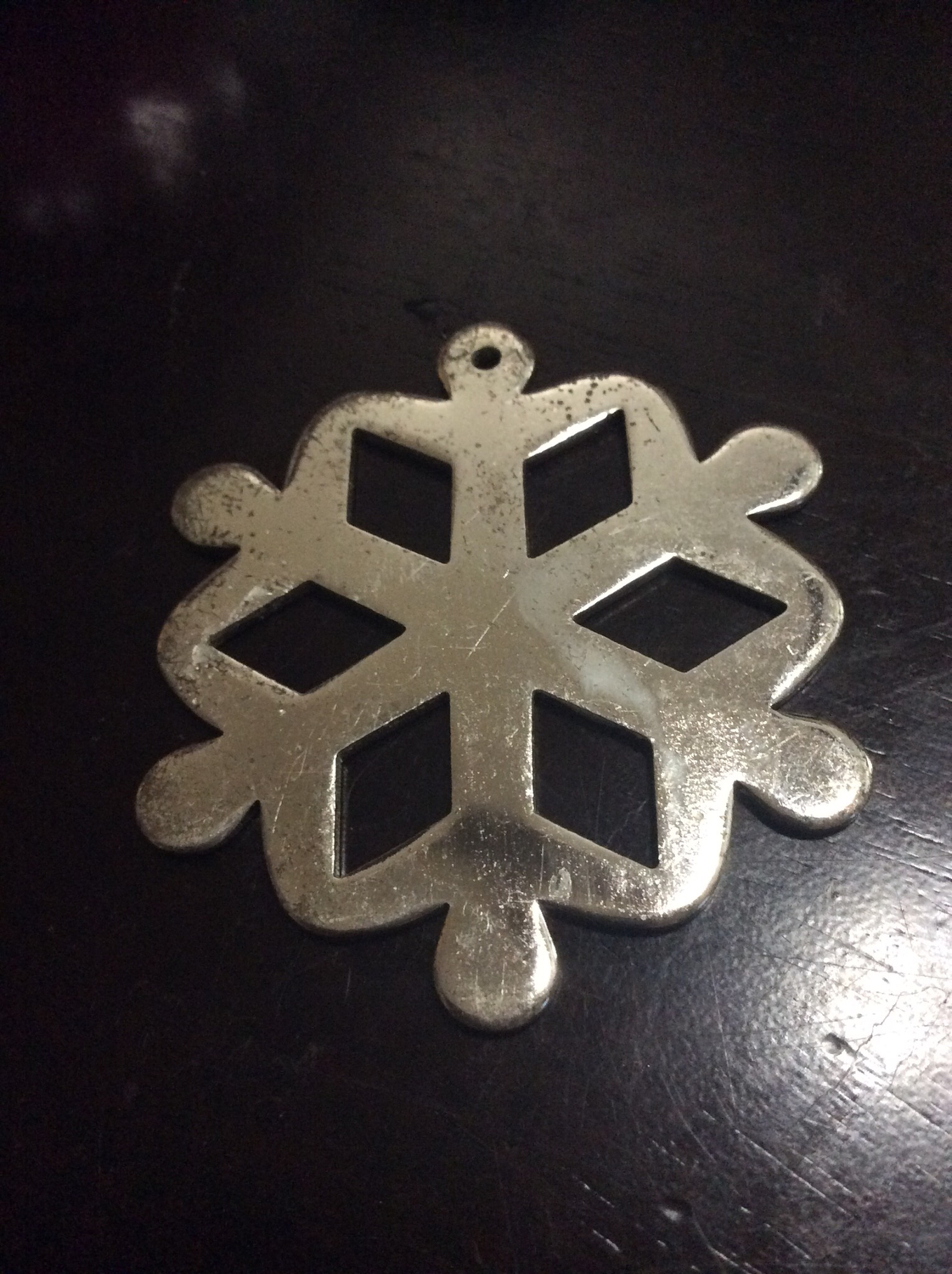 Metal snowflake ornament bring people together in harmony peace and joy