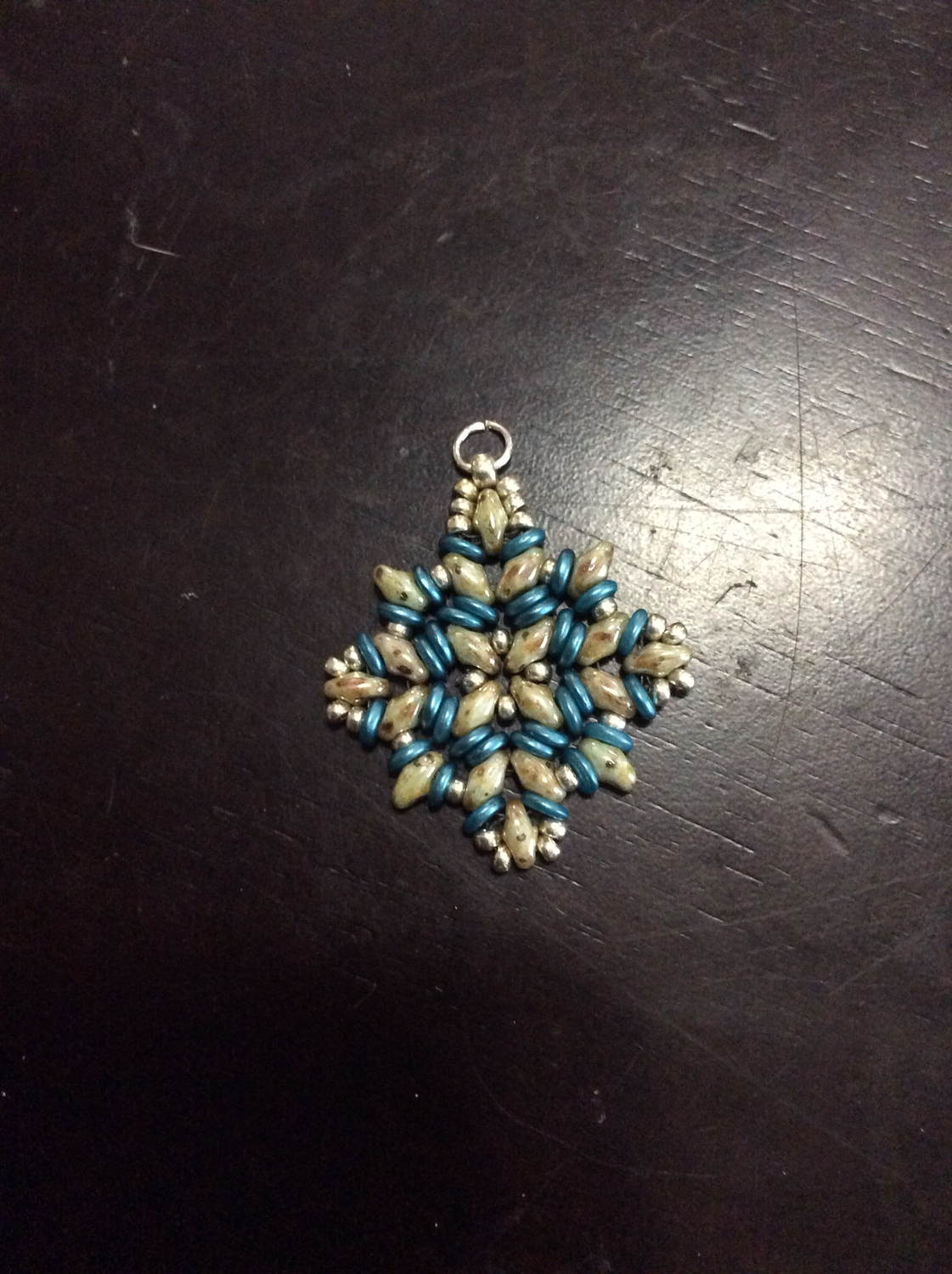 Small beaded charm anointed with sacred Bethesda incantations
