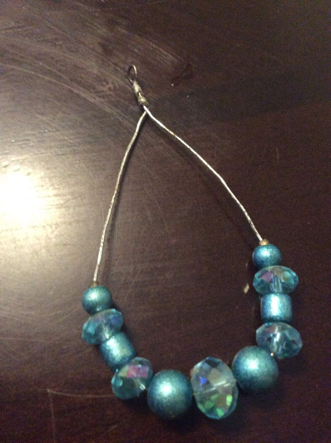 Wire charm with beads increase energy balance and flow through Dwelling