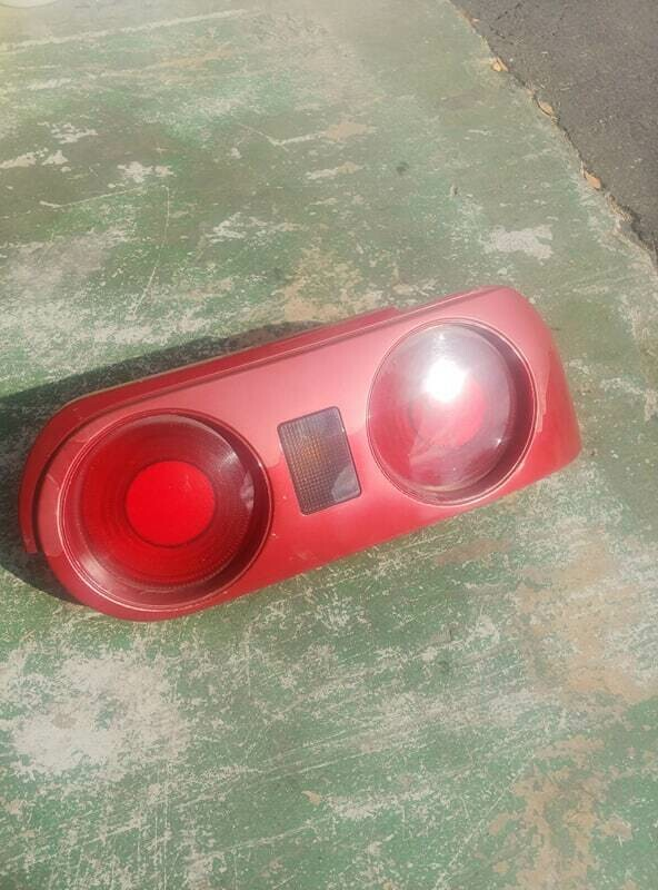 oem r32 coupe driver side tail light AH3 (used - clearcoat pealing)