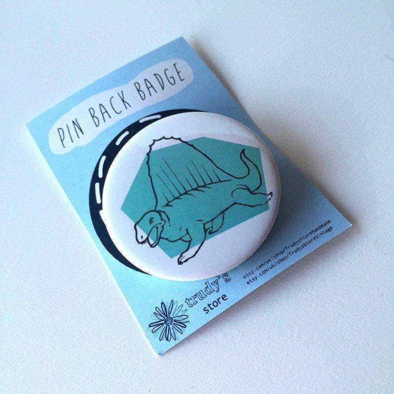 Blue Stegosaurus badge