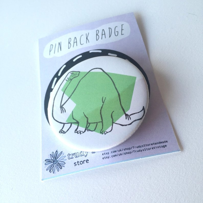 Green Brontosaurus badge