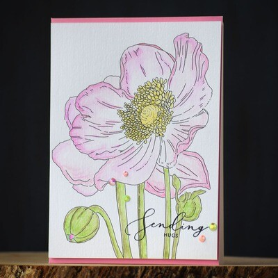 Watercolored pink flowers and a sentiment that says