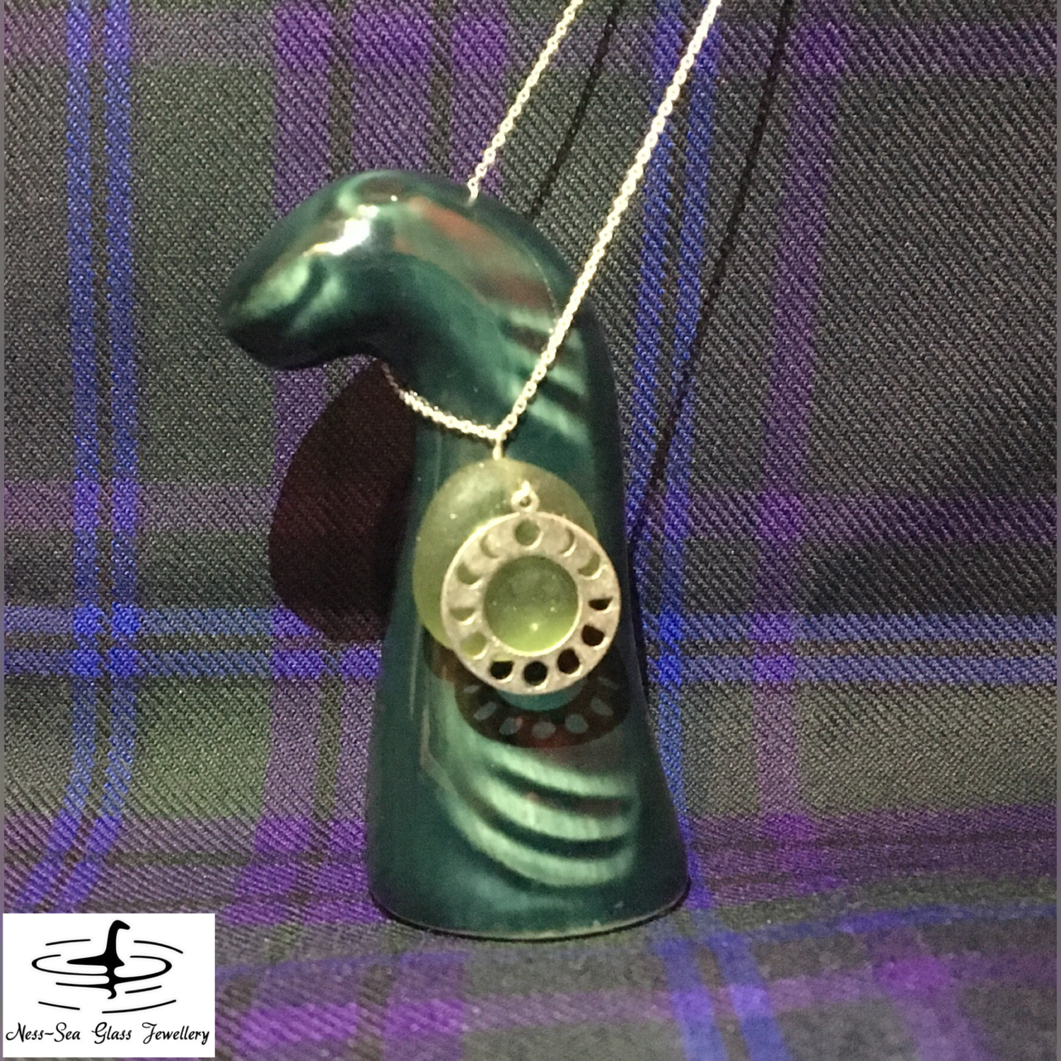 Green Loch Ness Sea Glass Necklace with Sterling Silver Luna Cycle detail and Fine Sterling Silver Chain.