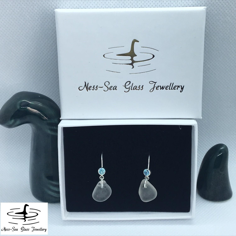 Clear Loch Ness Sea Glass Sterling Silver Hook Earrings with Light Blue Cubic Zirconia Gemstone Detail.