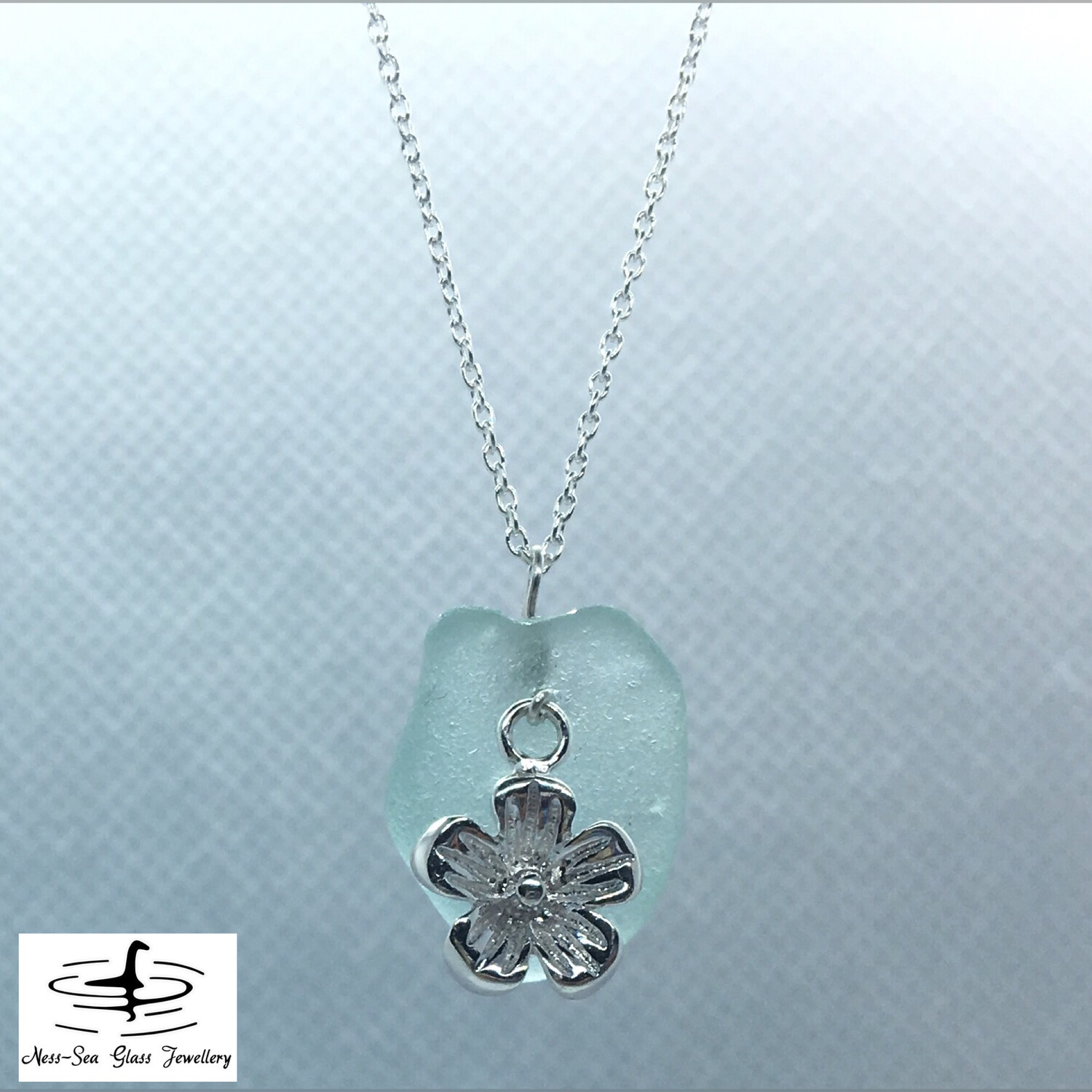 Blue Loch Ness Sea Glass Necklace with Sterling Silver Blossom Charm and Fine Sterling Silver Chain