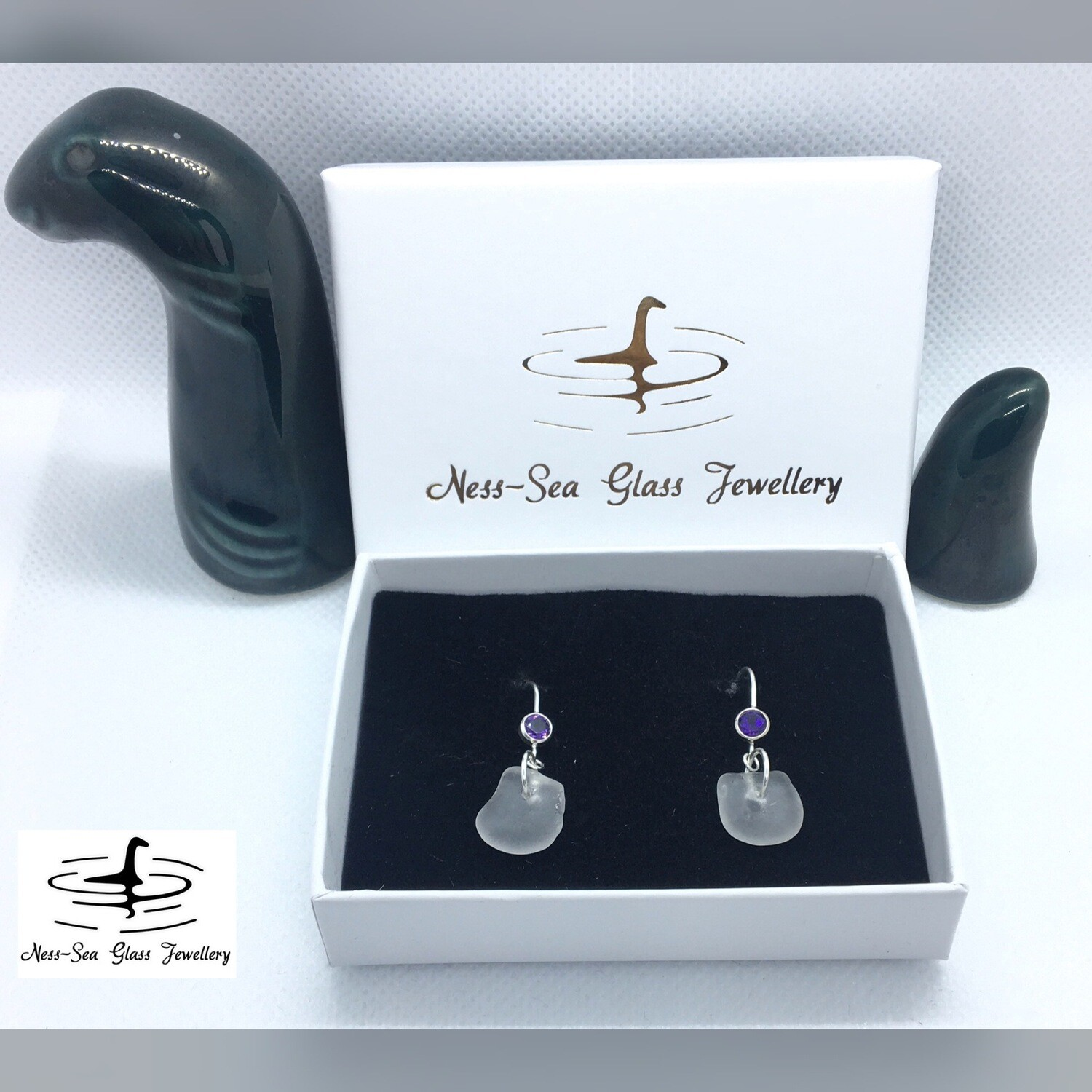 Clear Loch Ness Sea Glass Sterling Silver Hook Earrings with Purple Amethyst Gemstone Detail.