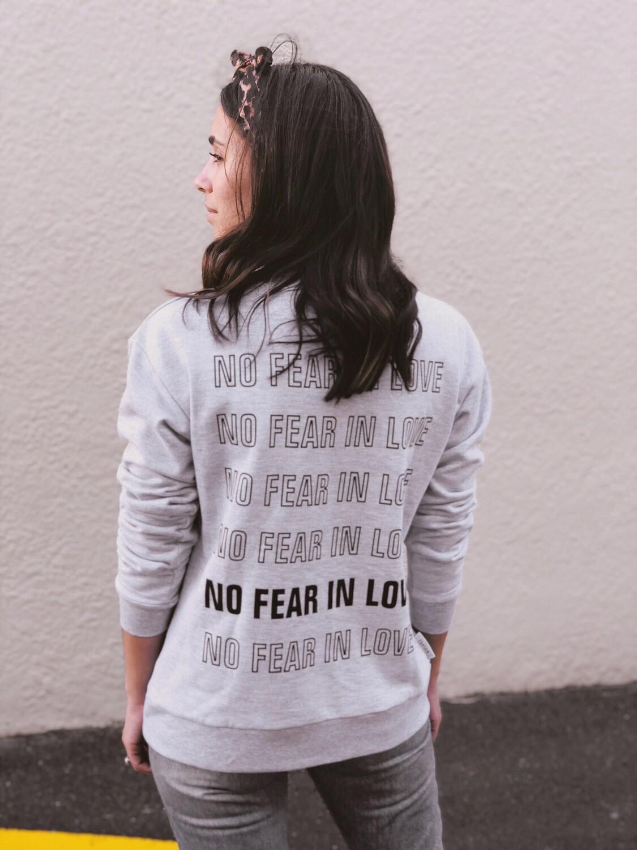 NO FEAR IN LOVE SWEATER