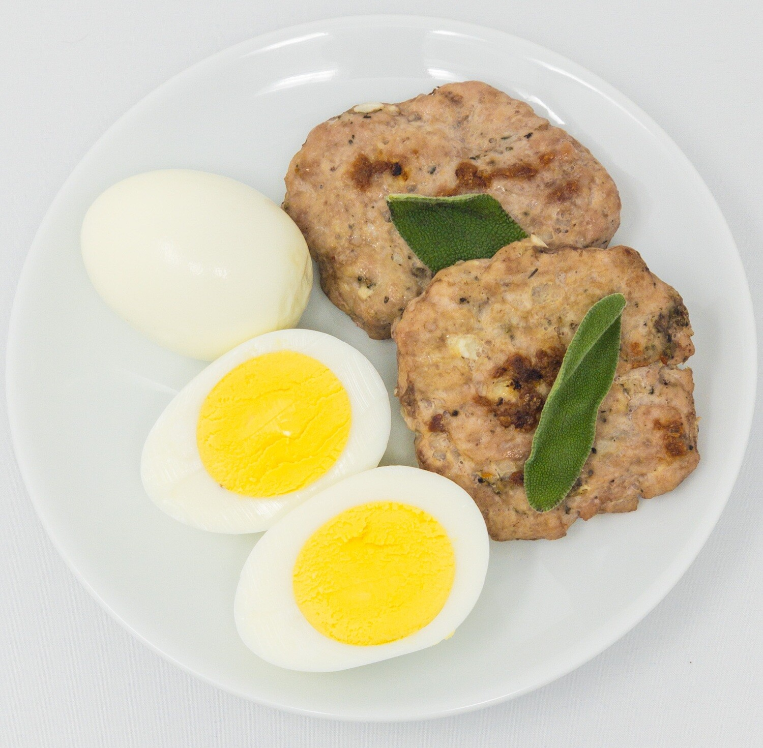 Snack on the go- Roasted Garlic and Sage Sausage Patties and Hard Boiled Eggs