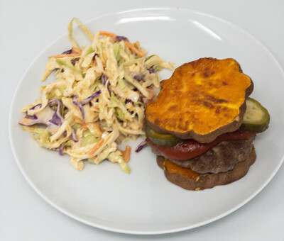 Grass fed And finished Burger With Sweet Potato Bun And Sriracha Lime Slaw