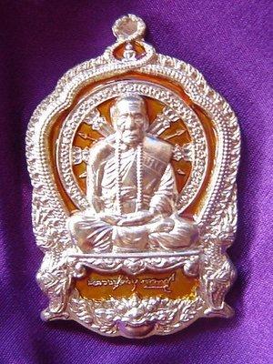 Rian Ba Chalu Nuea Tong Khaw (white gold sacred alloy)  - Long Ya Si Prajam Wan Gerd (Birthday color - Orange/Thursday) - Run Jaroen Baramee 89 (2554 BE) - Luang Phu Kambu - Wat Gut Chompoo - 499 made
