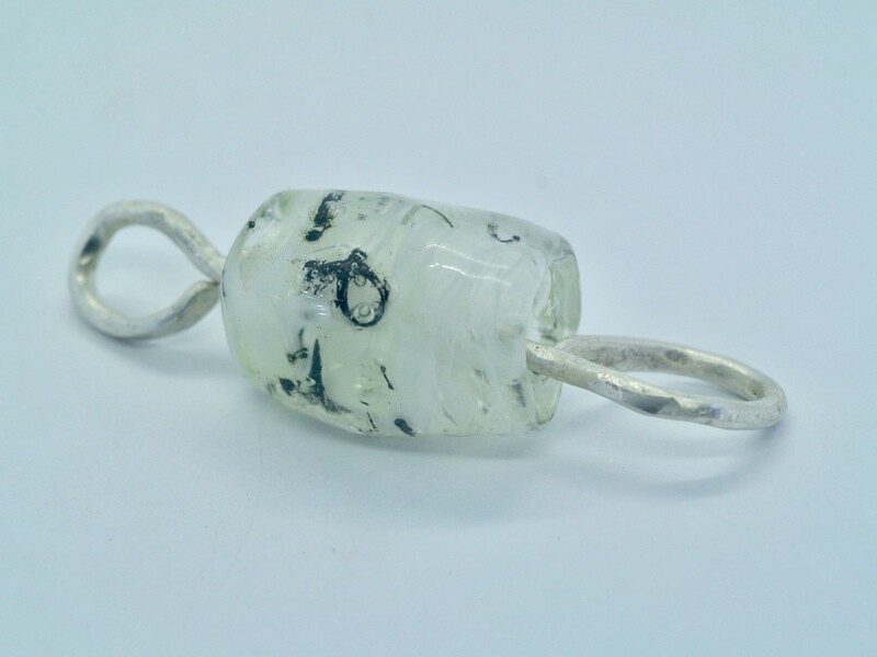 white emubead pendant with metal inclusions