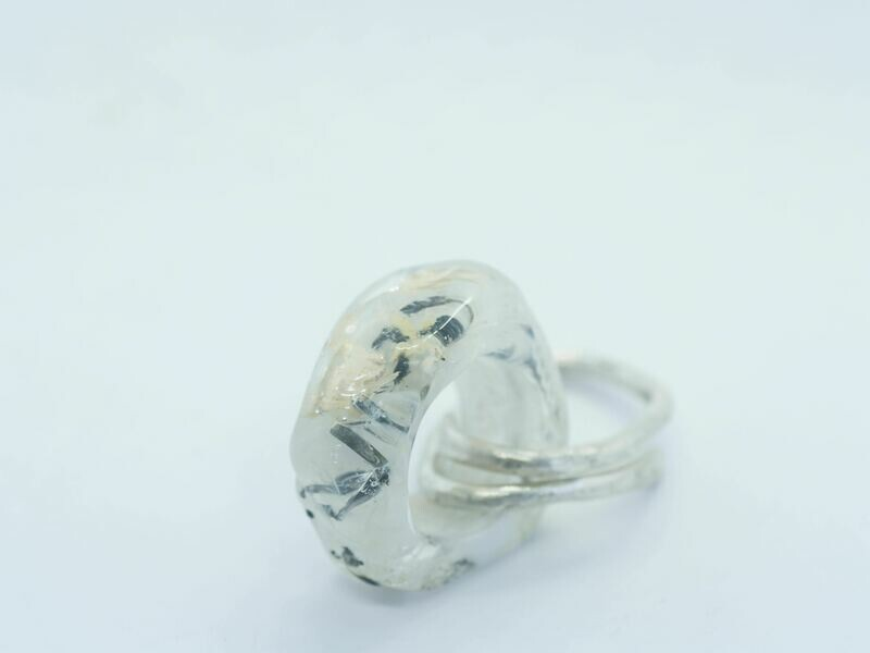 white emubead ring-form on silver link