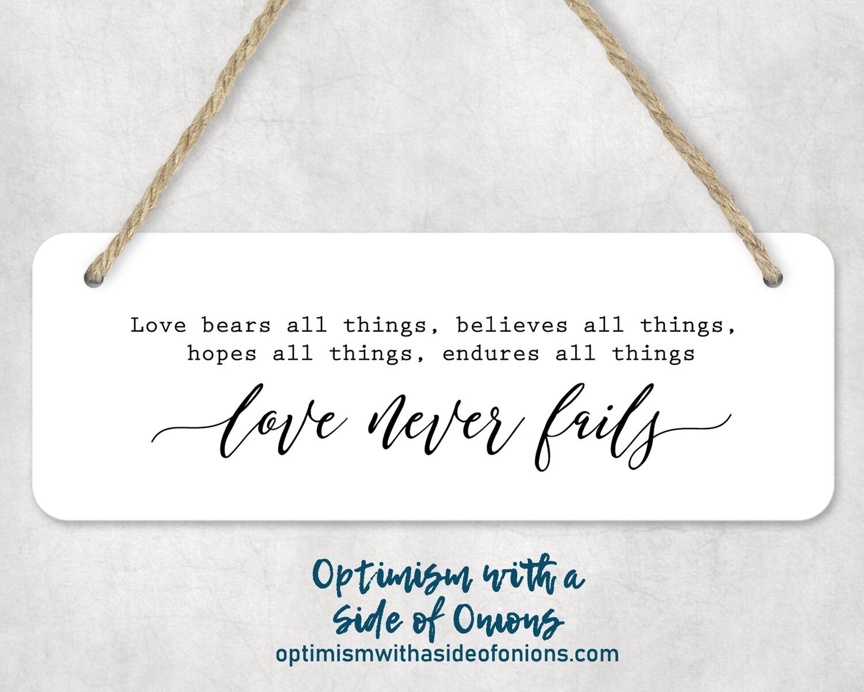 """""""Love Never Fails"""" Wall Decor"""