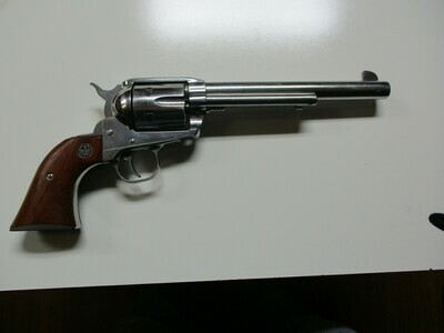 25 Ruger mod. Vaquero 45 cal revolver nickel w/wood grips ser # 55-66824
