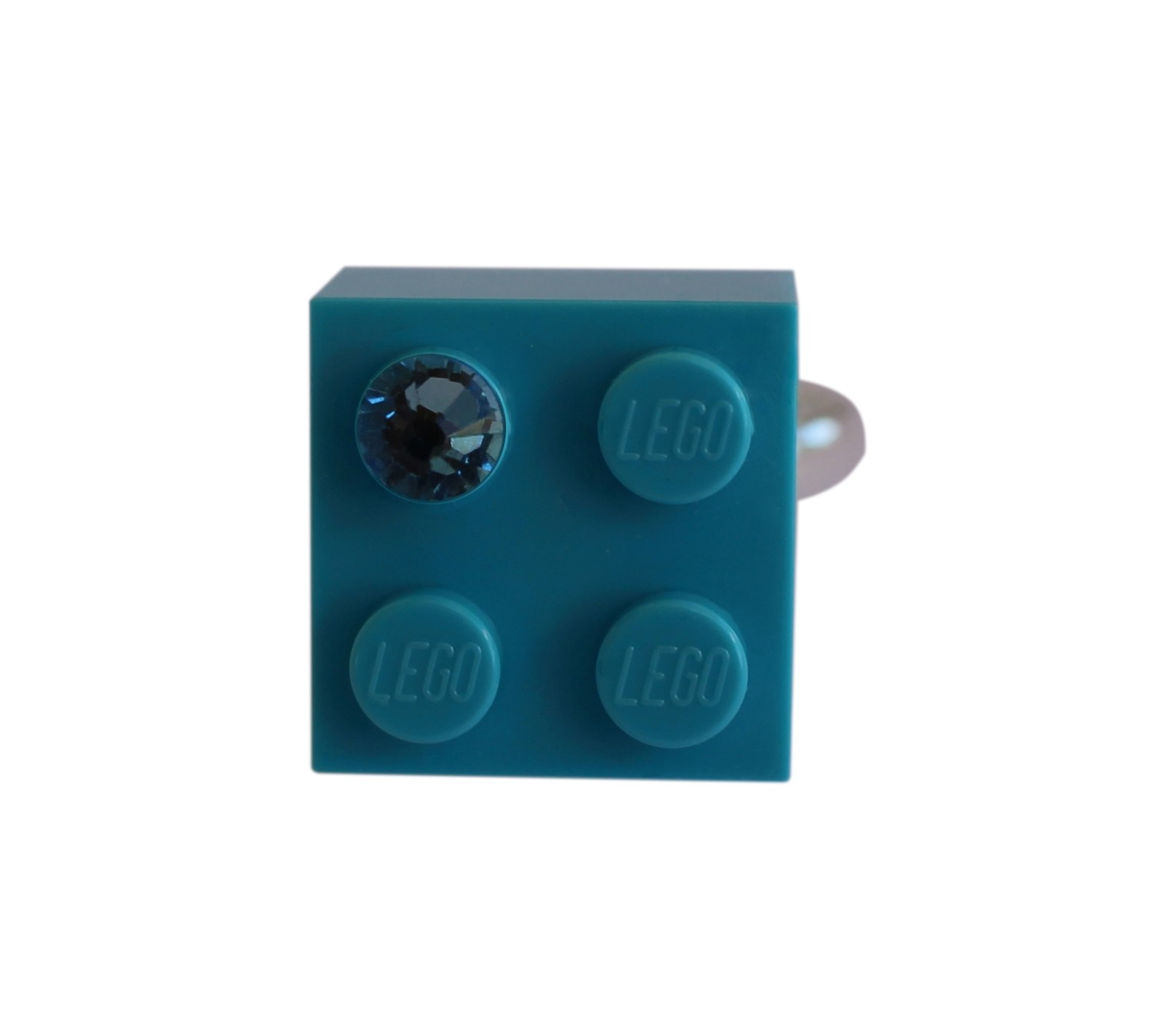 Turquoise Blue LEGO® brick 2x2 with a Blue SWAROVSKI® crystal on a Silver plated adjustable ring finding