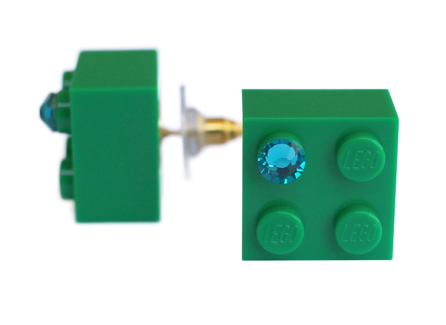 ​Dark Green LEGO® brick 2x2 with a Green SWAROVSKI® crystal on a Gold plated stud/silicone back stopper
