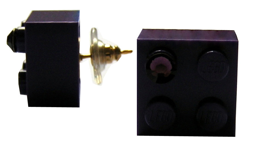 Purple LEGO® brick 2x2 with a Purple SWAROVSKI® crystal on a Gold plated stud/silicone back stopper