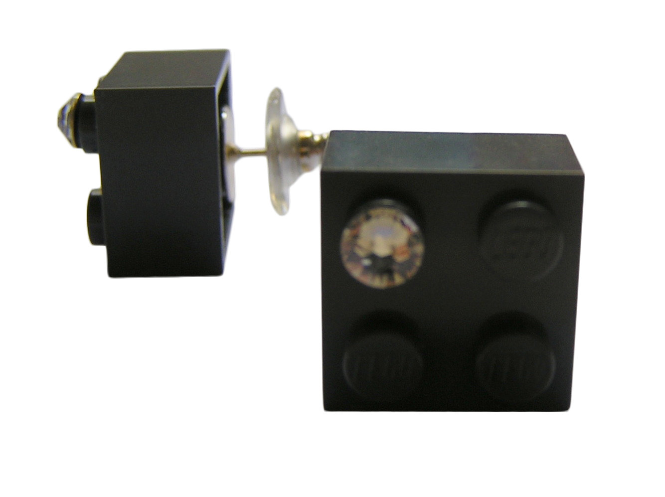Gray LEGO® brick 2x2 with a 'Diamond' color SWAROVSKI® crystal on a Silver plated stud/silicone back stopper