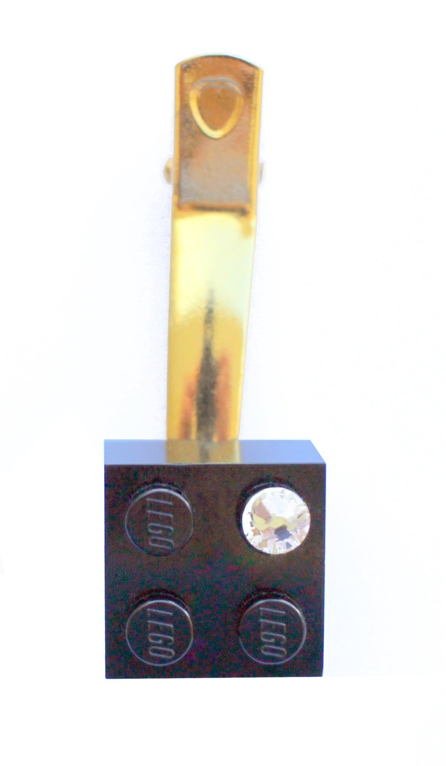 Black LEGO® brick 2x2 with a 'Diamond' color SWAROVSKI® crystal on a Gold plated hair clip (one piece)