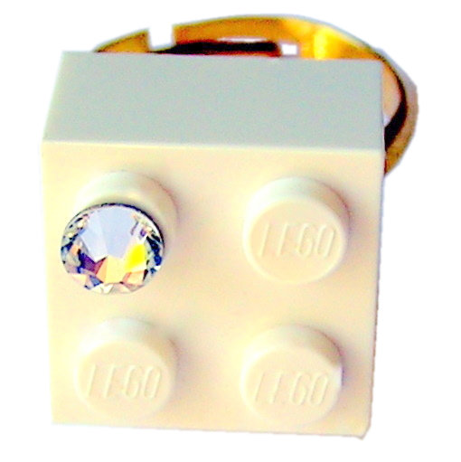 White LEGO® brick 2x2 with a 'Diamond' color SWAROVSKI® crystal on a Gold plated adjustable ring finding