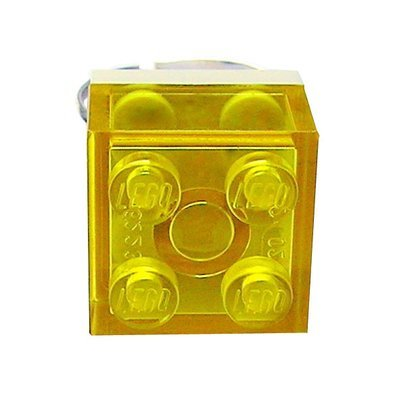 Transparent Yellow LEGO® brick 2x2 on a Silver plated adjustable ring finding
