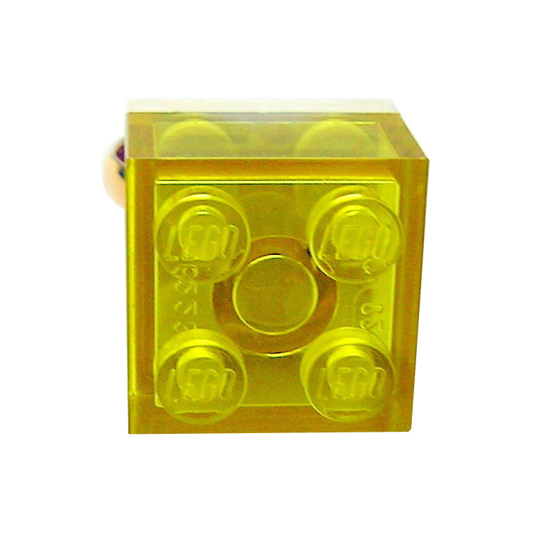Transparent Yellow LEGO® brick 2x2 on a Gold plated adjustable ring finding