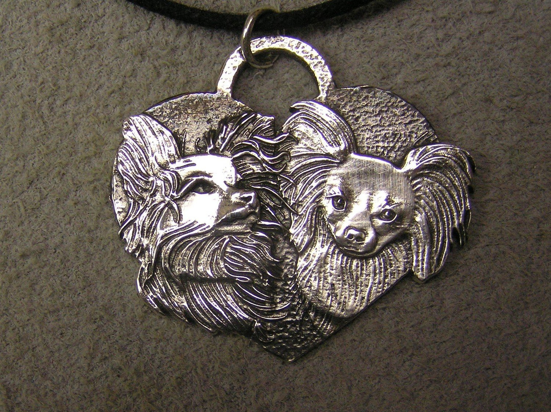 Papillon heart shaped sterling silver pendant