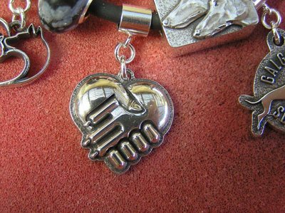 RESCUED  modern Sterling silver charm