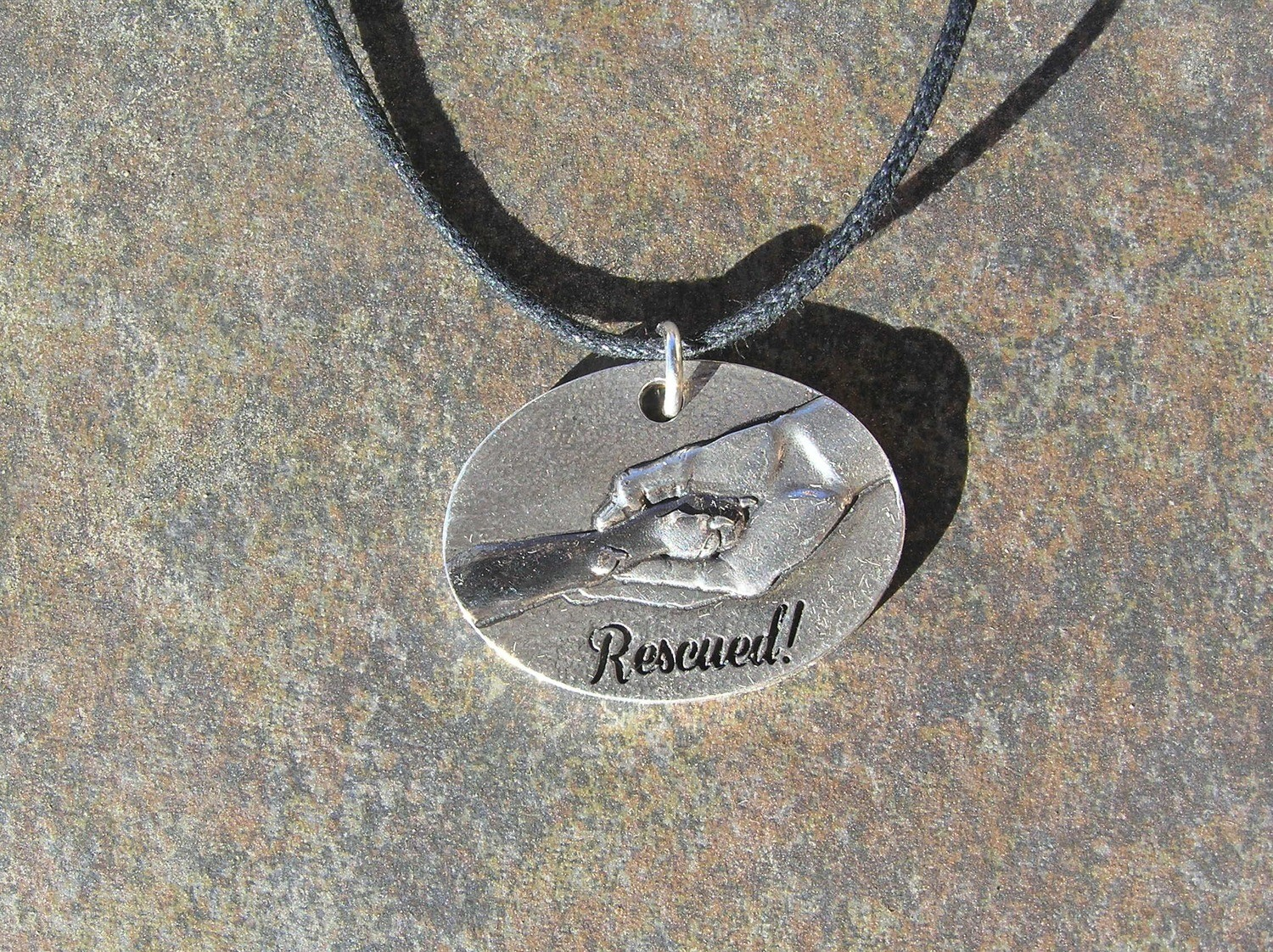 Rescued sterling silver pendant