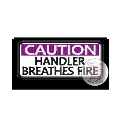 Caution: Handler Breathes Fire
