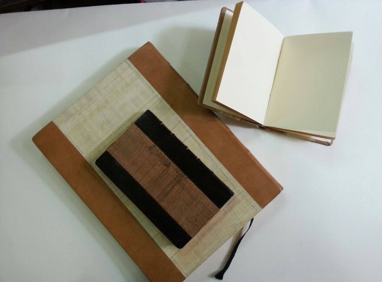 Leather/papyrus covered blank paper journal .